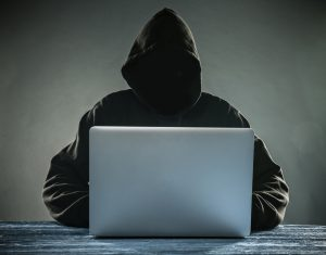 Hacker accessing passwords for identity theft