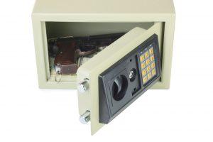 A handgun and cash stored in a digital safe