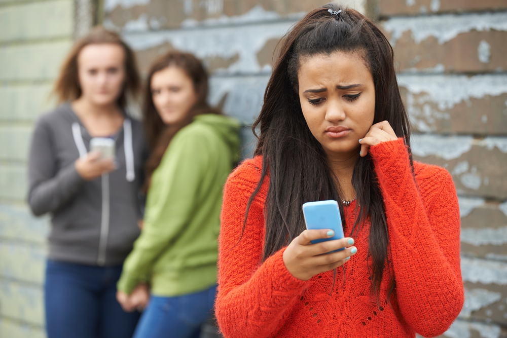 Girl being cyberbullied.