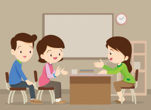 Teacher having a conference with parents
