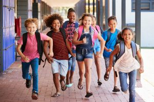 Kids running to class.