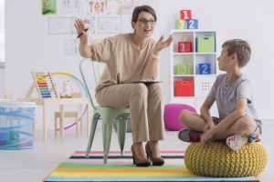 Positive school counselors works with boy.