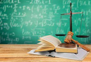 Law books against chalkboard.