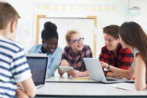 students using school laptops.