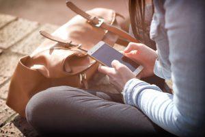 Girl sends smartphone text.