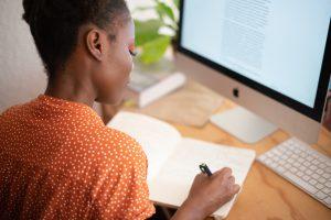 Teenage girl studies on computer.