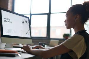 Girl uses school computer.