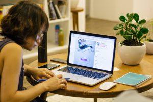 Female teenage student works online.